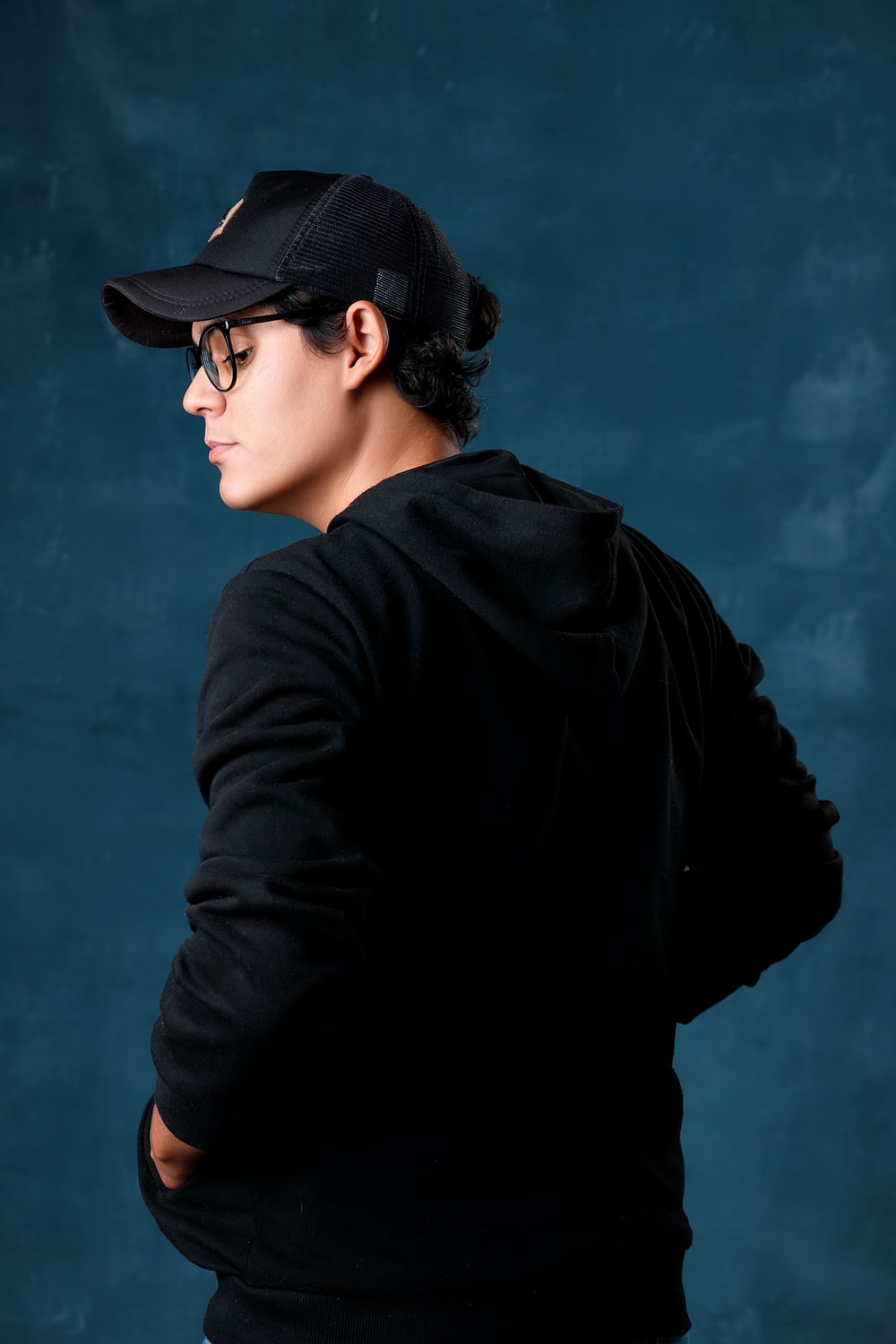 woman in black hat and black jacket