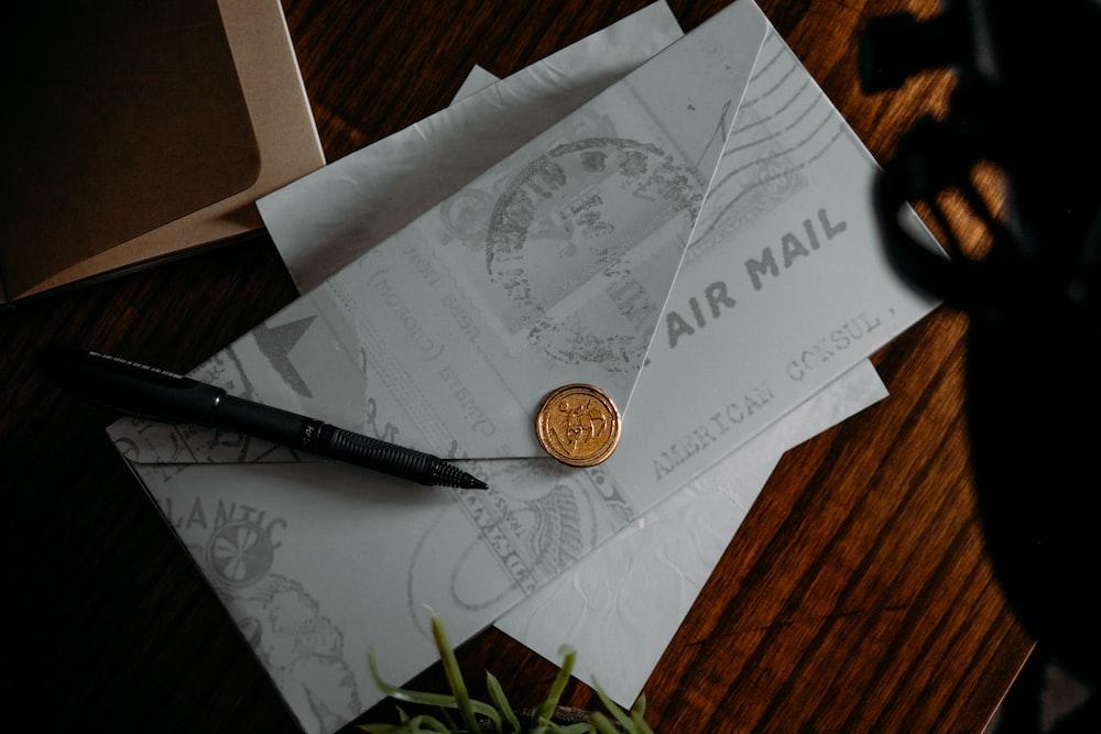 silver round coin on white printer paper
