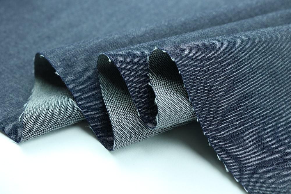 black strap on blue textile