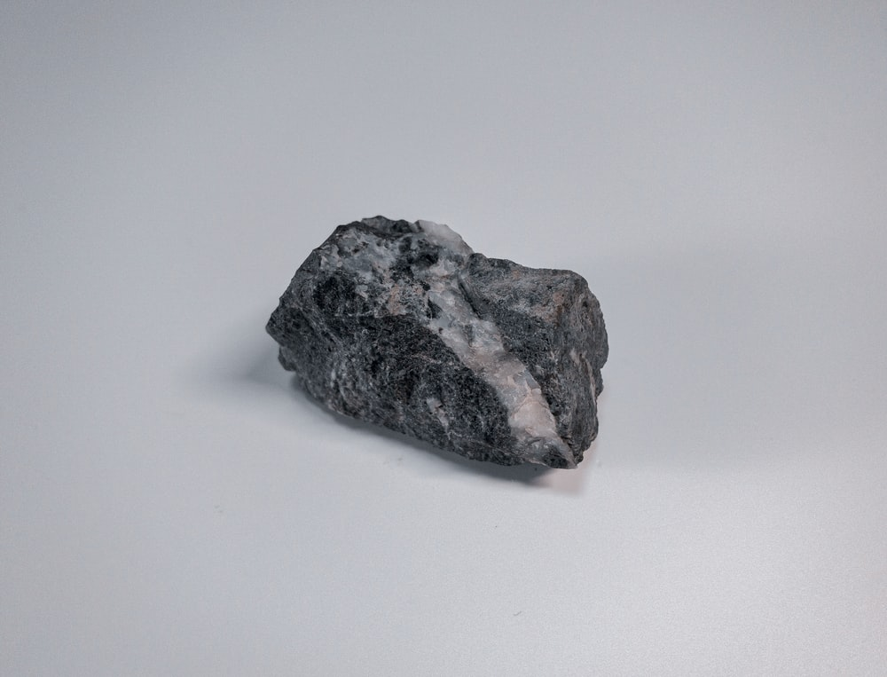 black and gray stone on white surface
