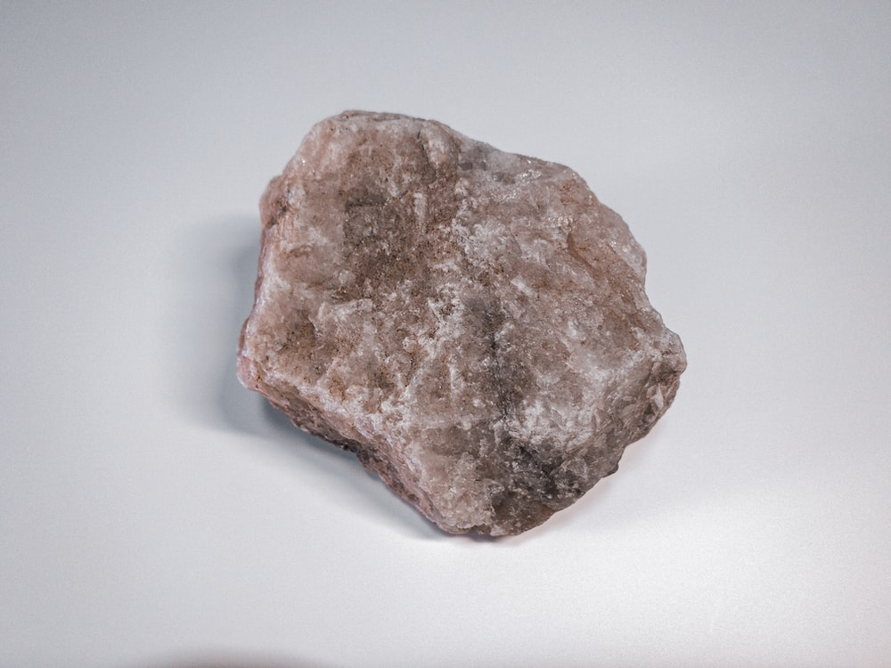 brown and gray stone on white surface