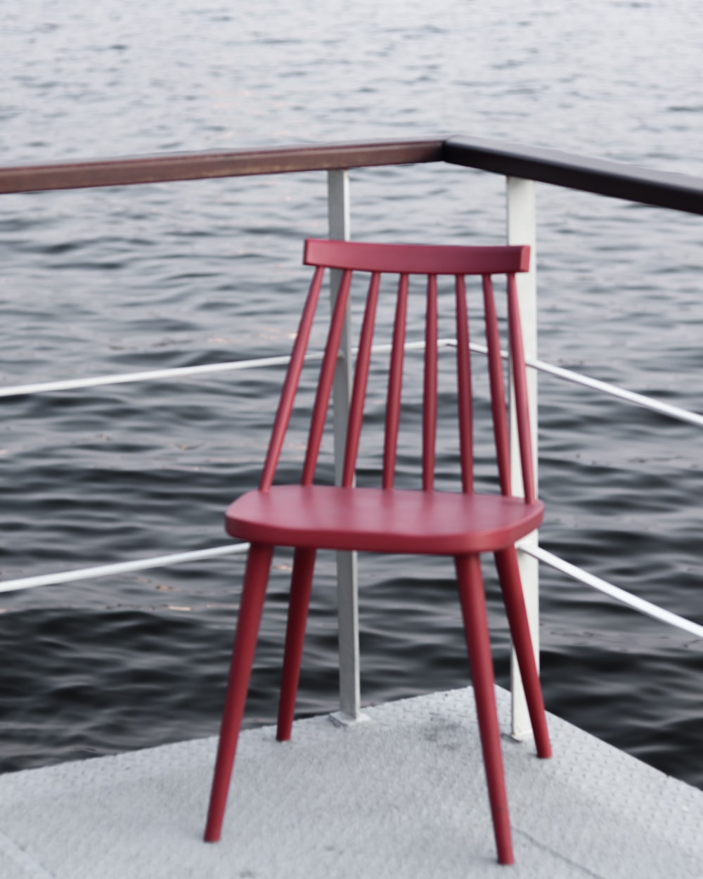red wooden chair on gray concrete floor