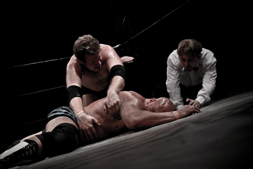 2 men lying on floor