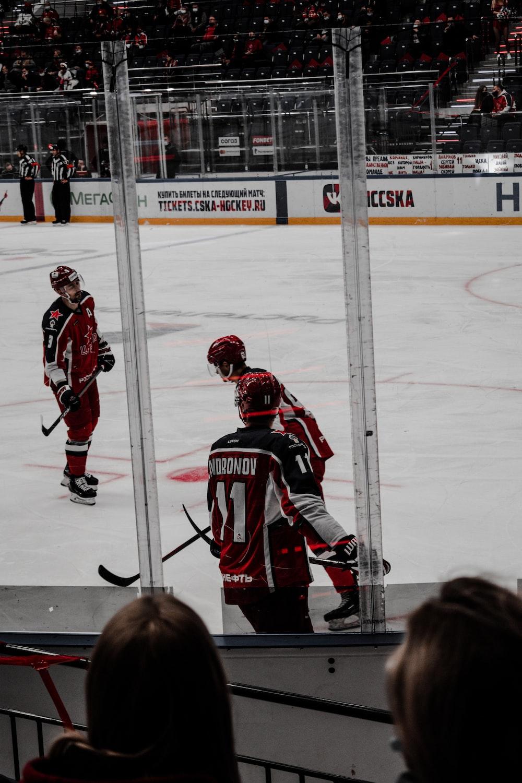 2 men playing ice hockey