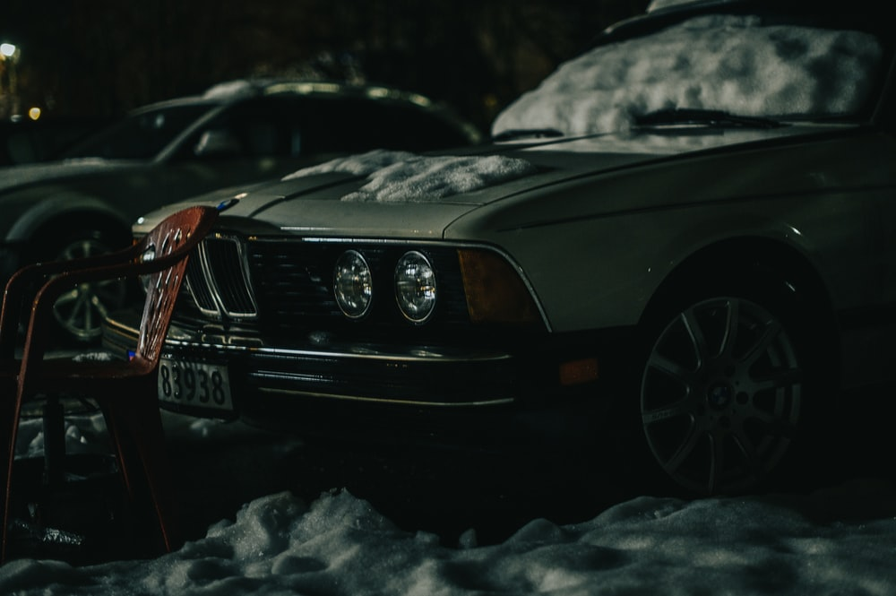black mercedes benz car on snow covered ground during daytime