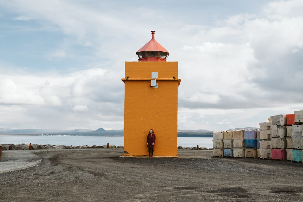 yellow and red concrete building on beach shore during daytime