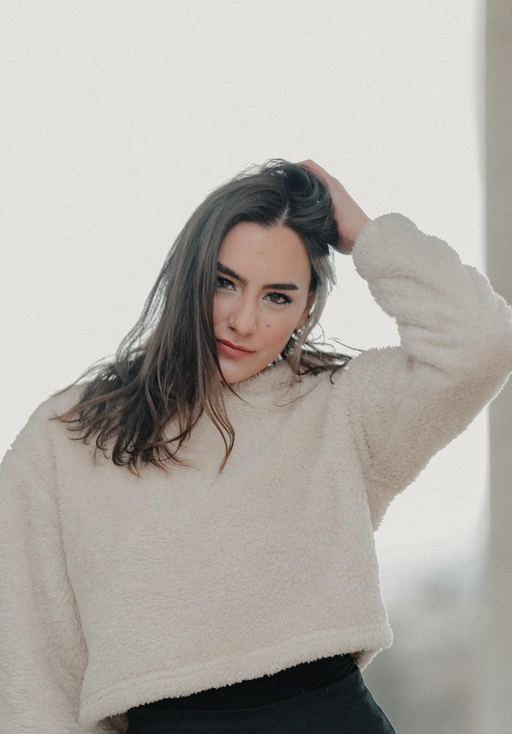woman in beige long sleeve shirt