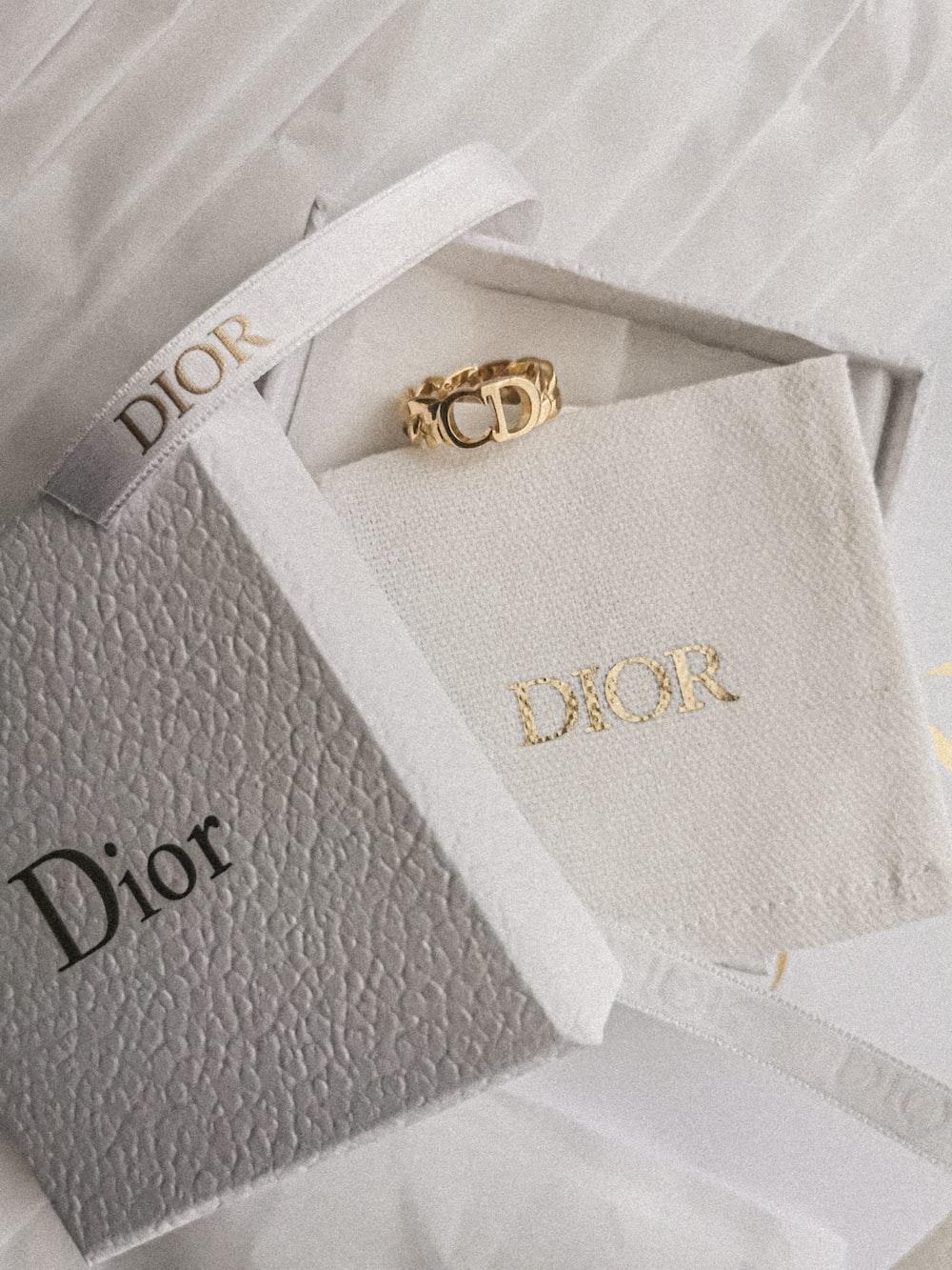 gold and diamond ring on white textile
