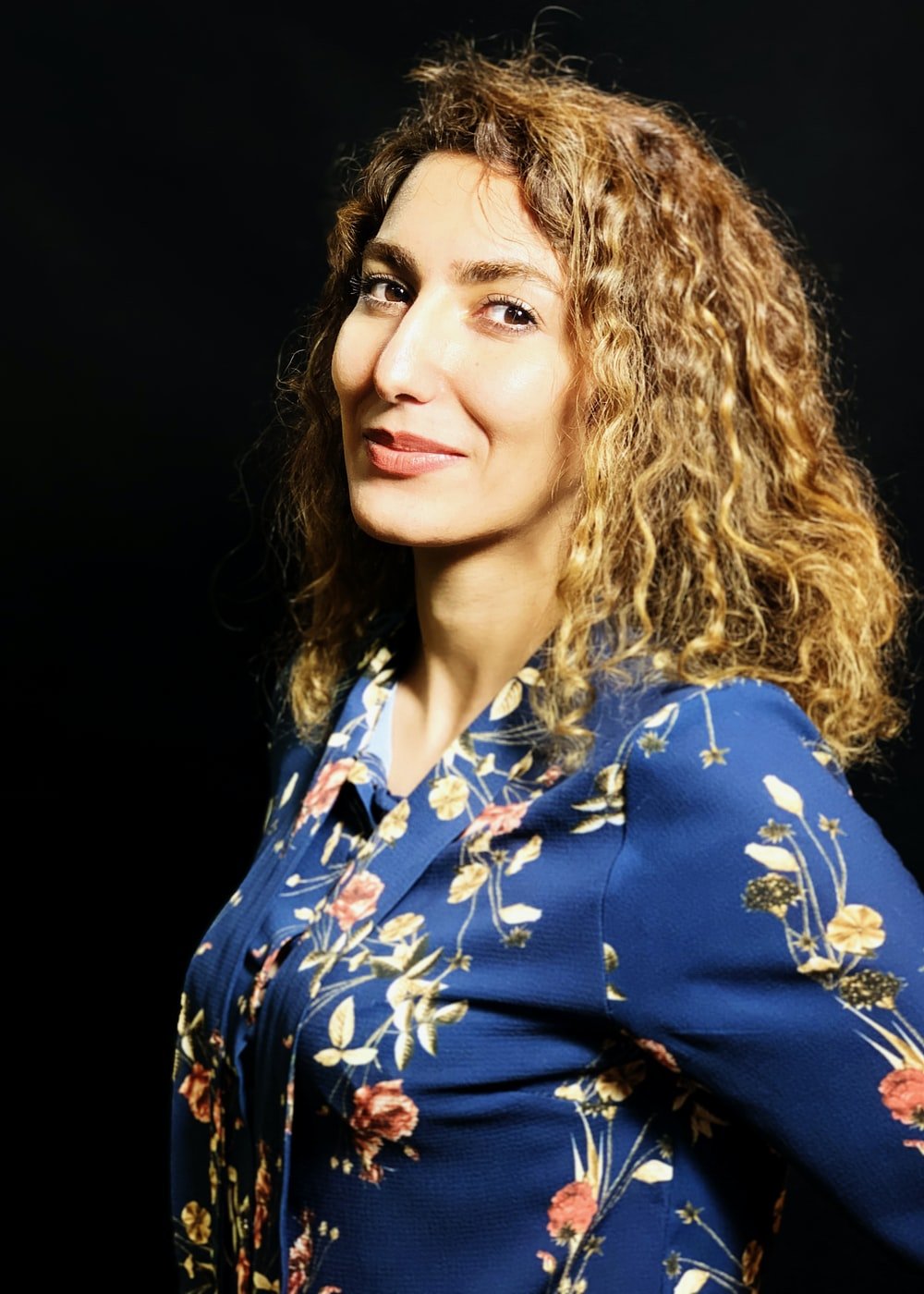woman in blue white and red floral button up shirt
