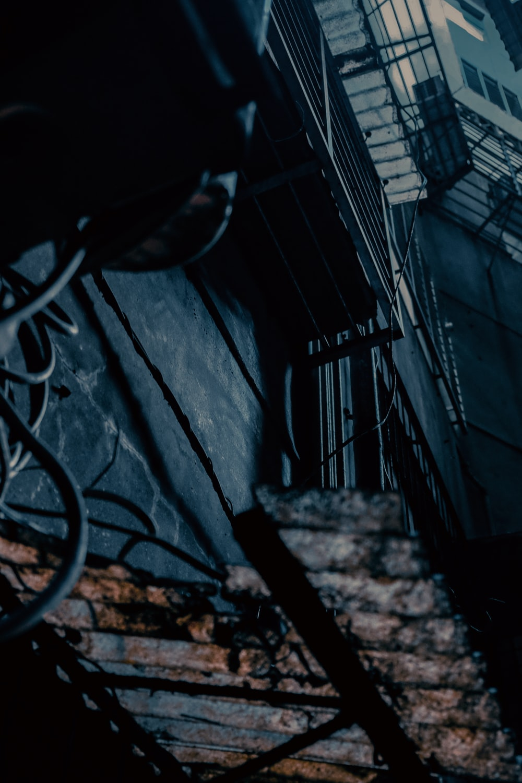 black metal fence near white wall