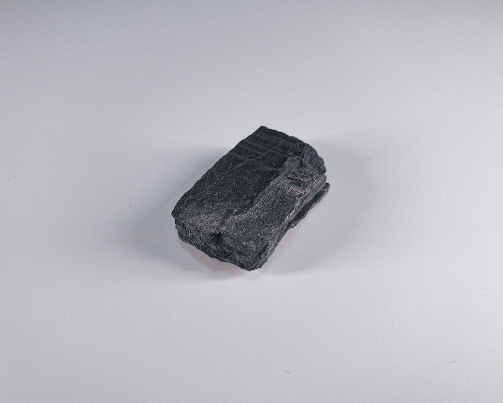 black stone on white surface