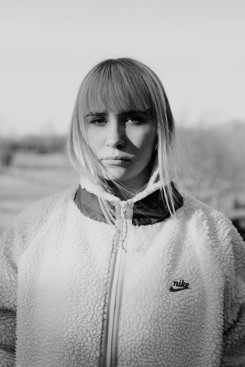 woman in white zip up jacket