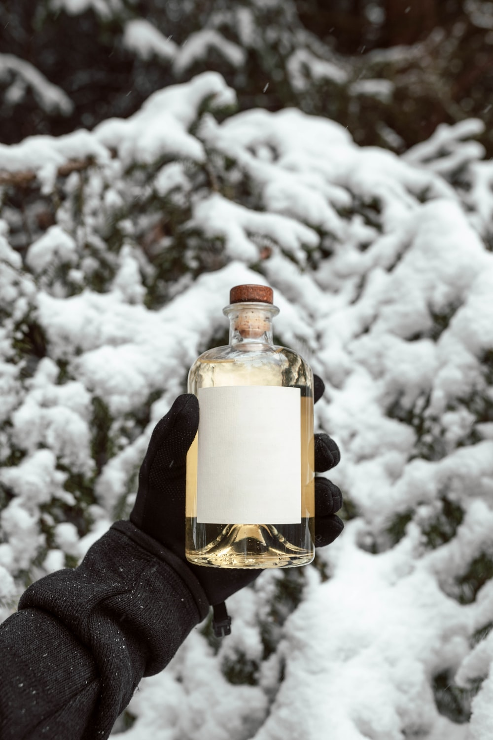 clear glass bottle with white snow