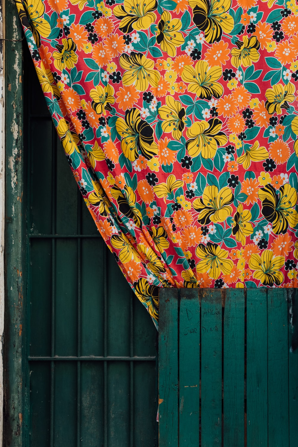 yellow red and blue floral textile