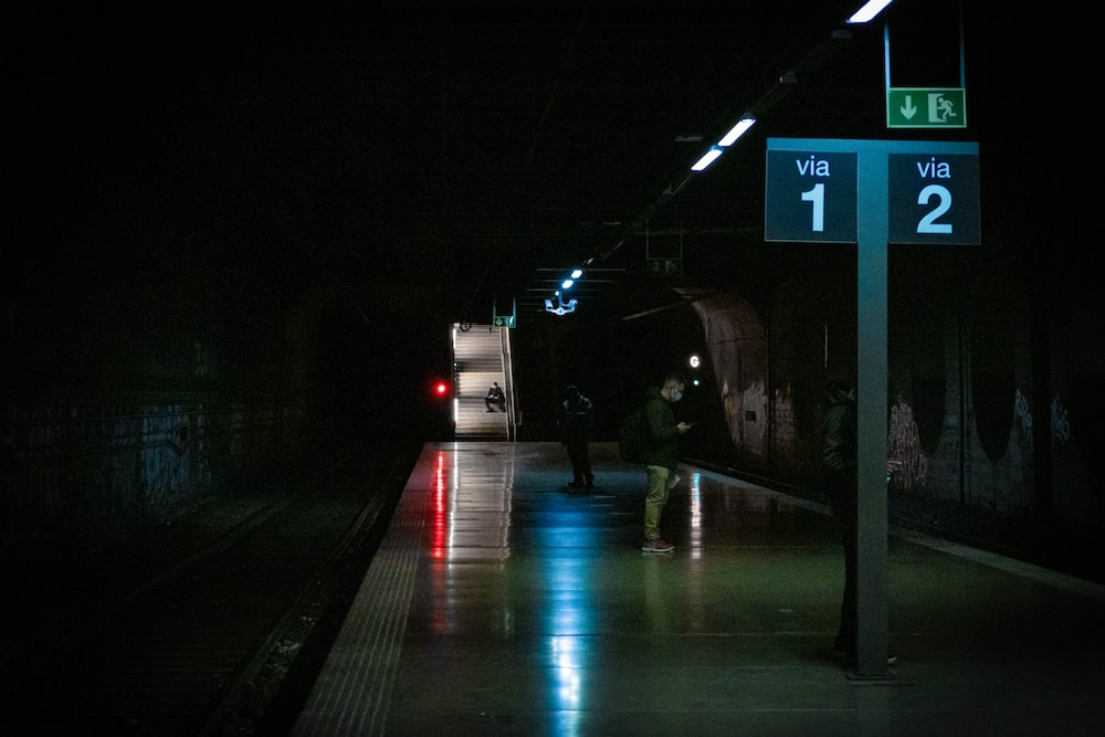 white and black train on rail road during night time