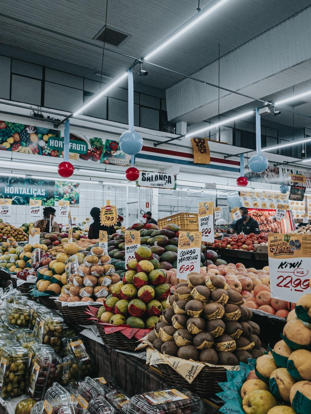 fruit display in market during daytime