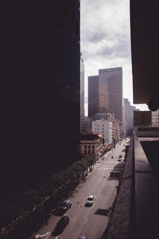 people walking on sidewalk near high rise buildings during daytime