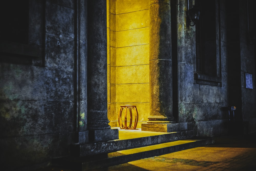 brown concrete pillar on gray concrete floor