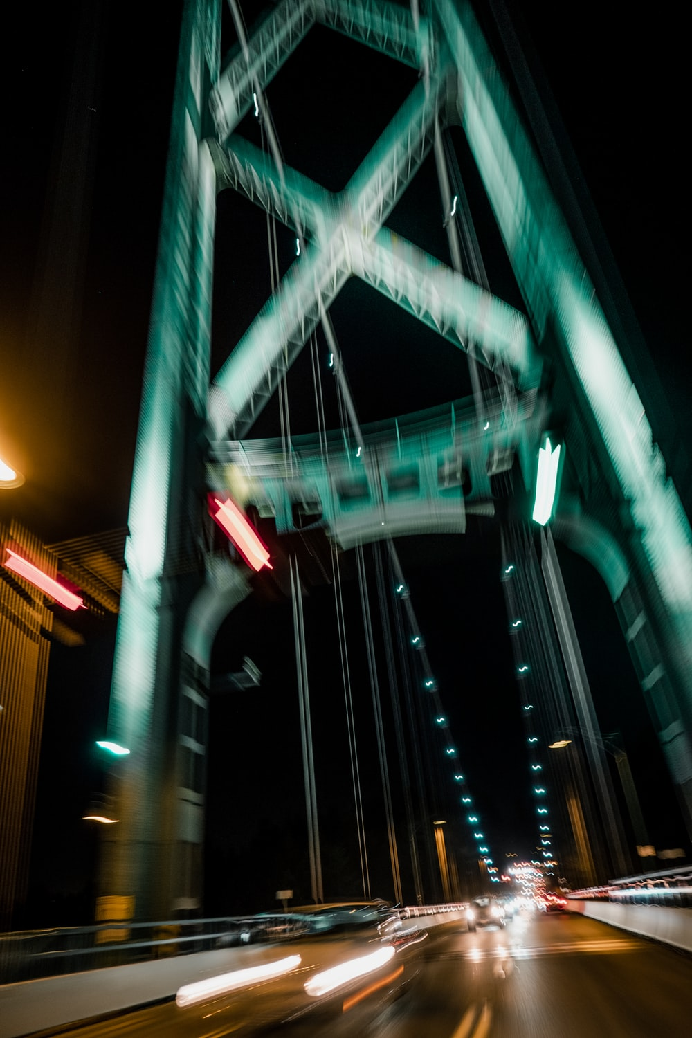 green and white bridge during night time