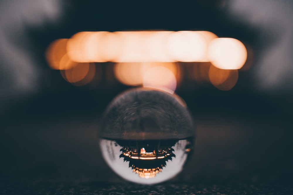 clear glass ball on black surface