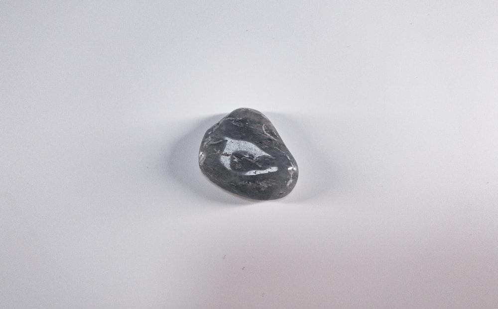black stone on white table