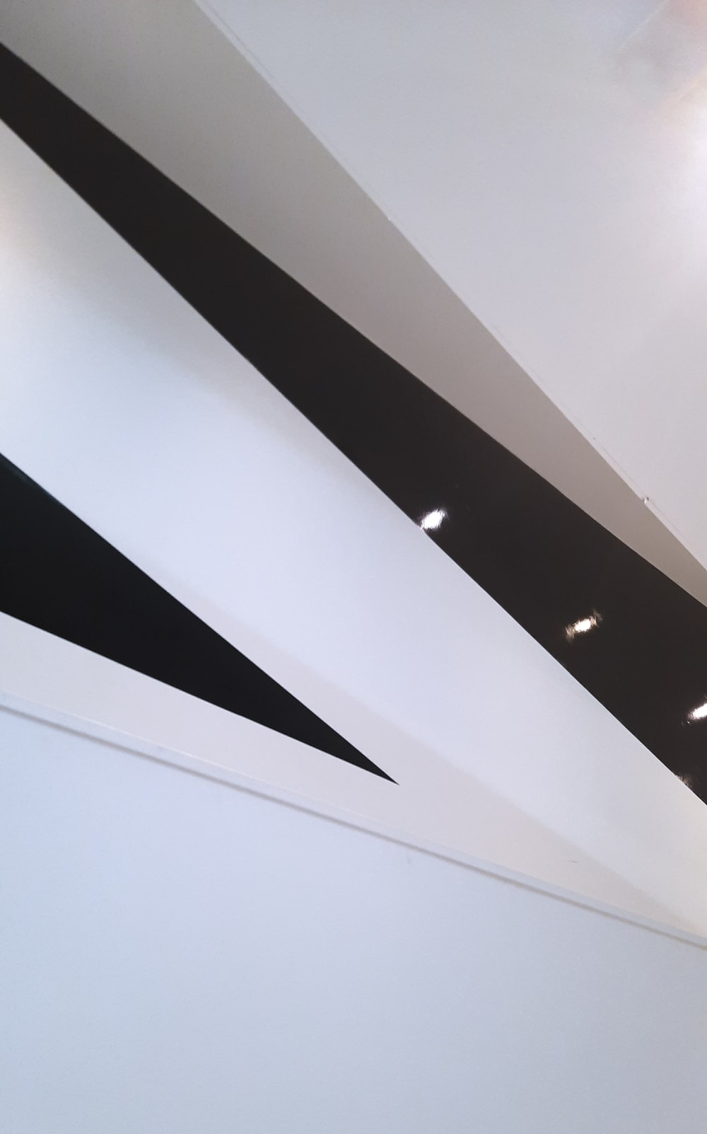 white and black ceiling with light fixture