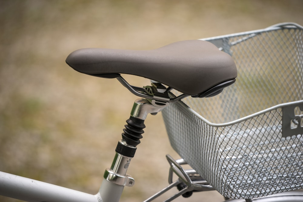 black and gray bicycle with basket