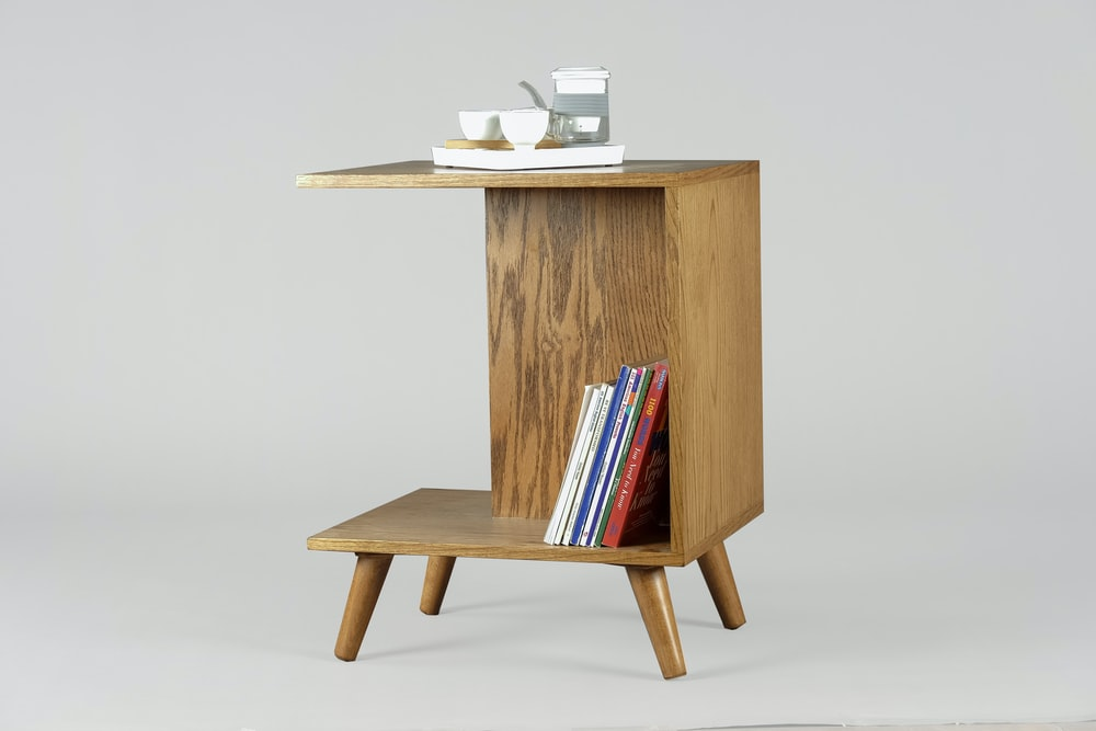 brown wooden table with books and mugs