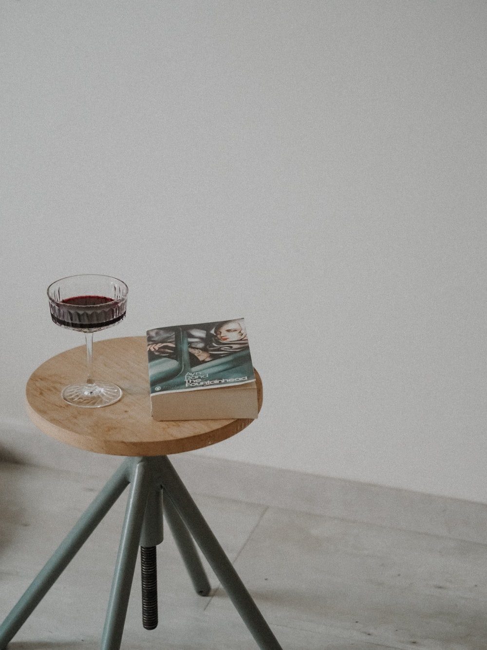 2 wine glasses on brown wooden table
