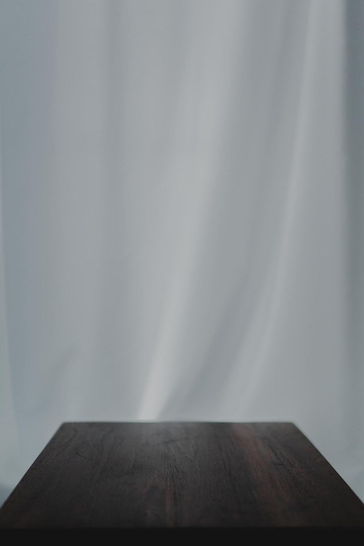 white textile near brown wooden table