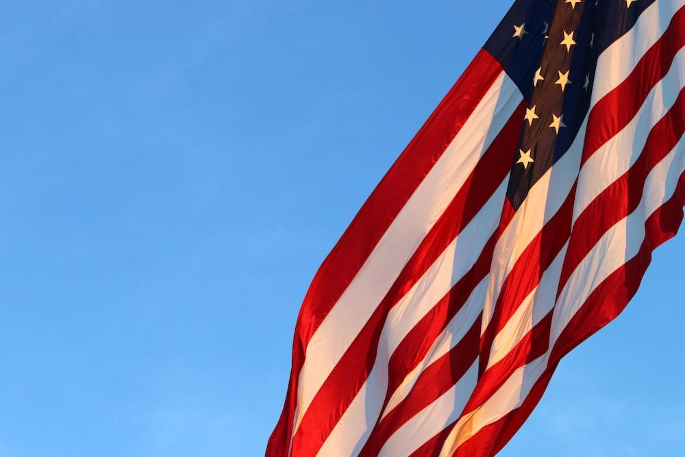 us a flag under blue sky during daytime