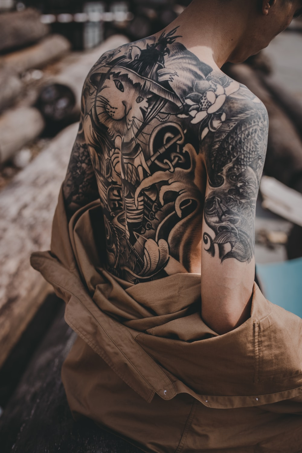 person in brown and black floral long sleeve shirt
