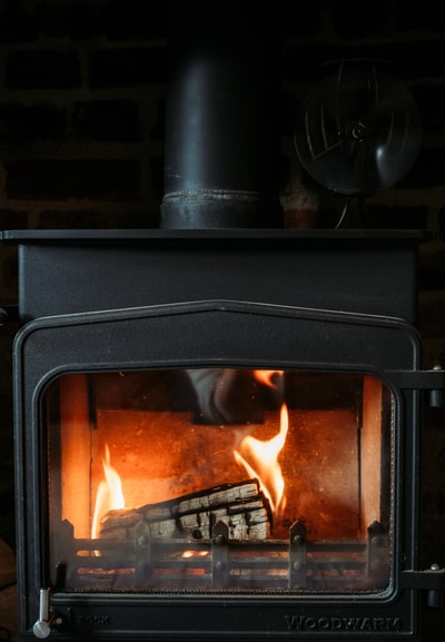 black wood burner with fire