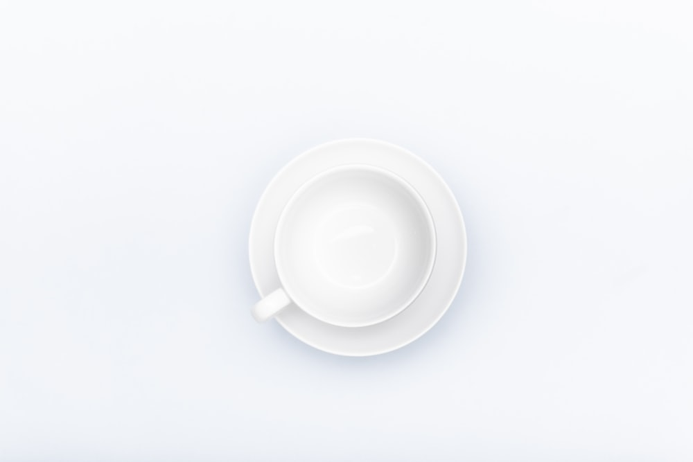 white ceramic mug on white surface