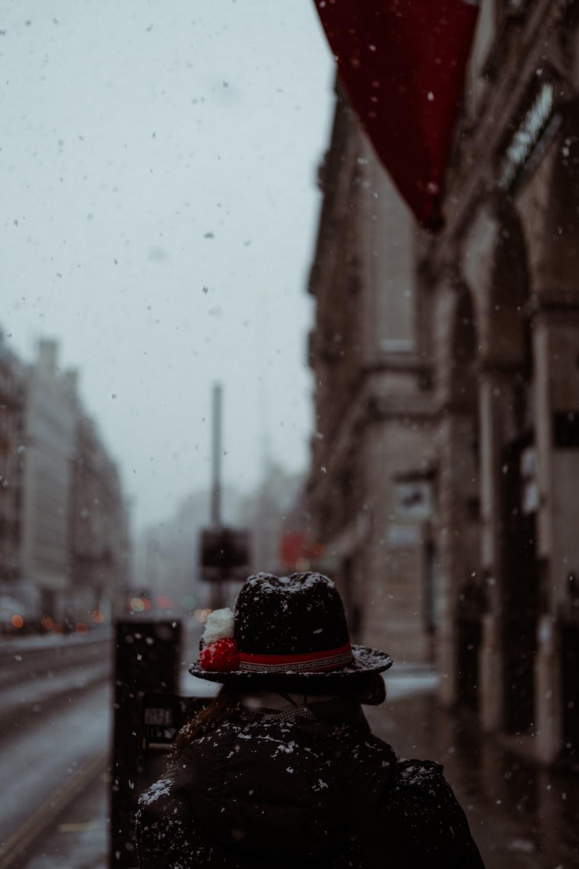 red and black hat on black asphalt road during daytime