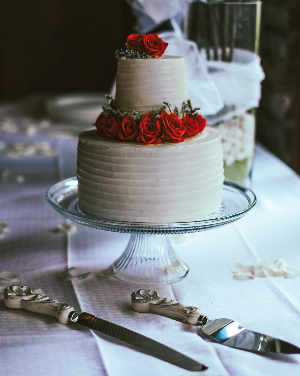 white and red cake on clear glass cake stand