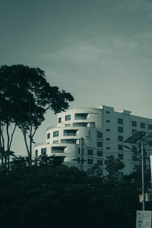 white concrete building near trees