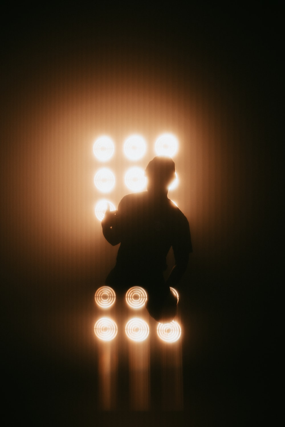 silhouette of man sitting on chair