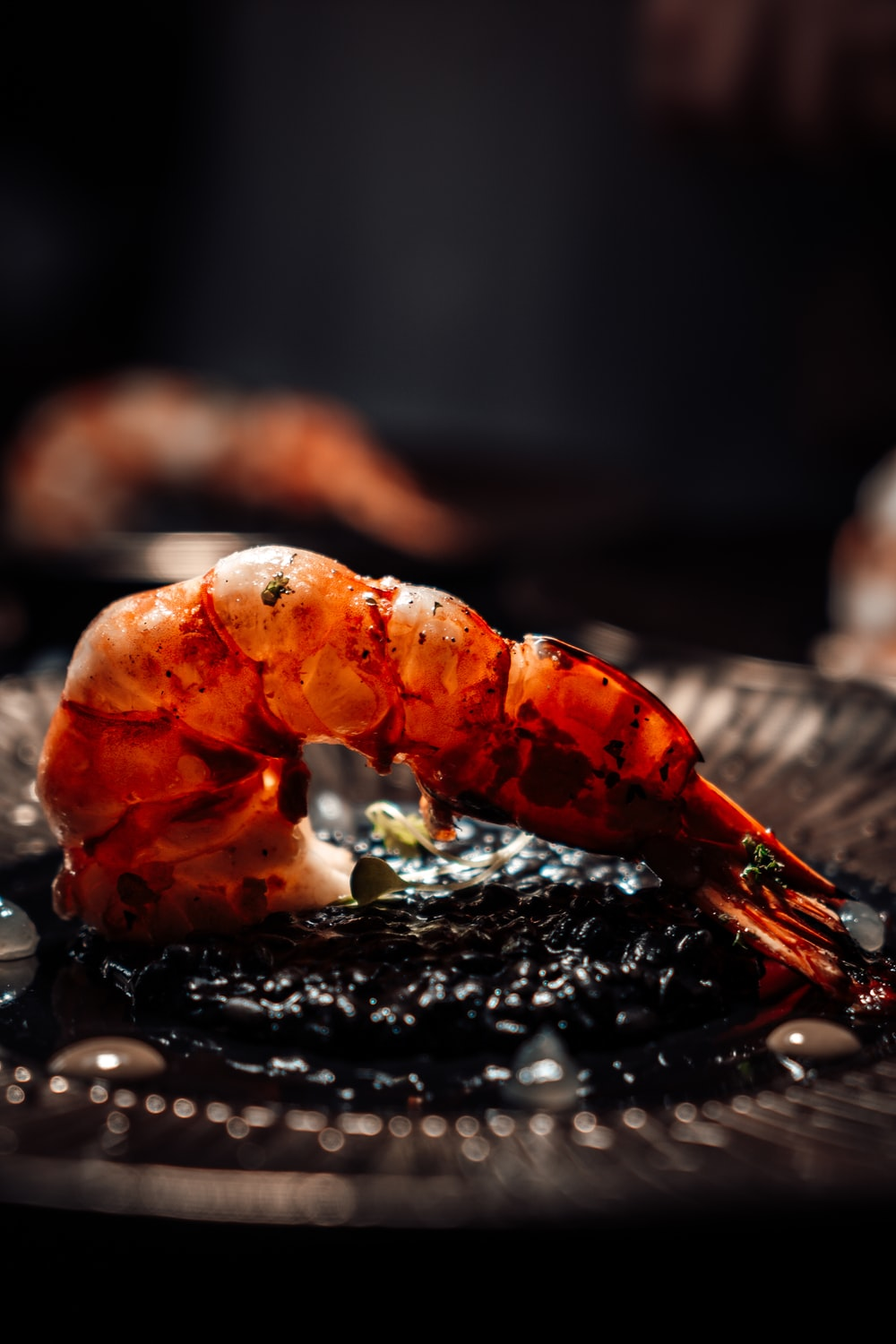cooked shrimp on black round plate