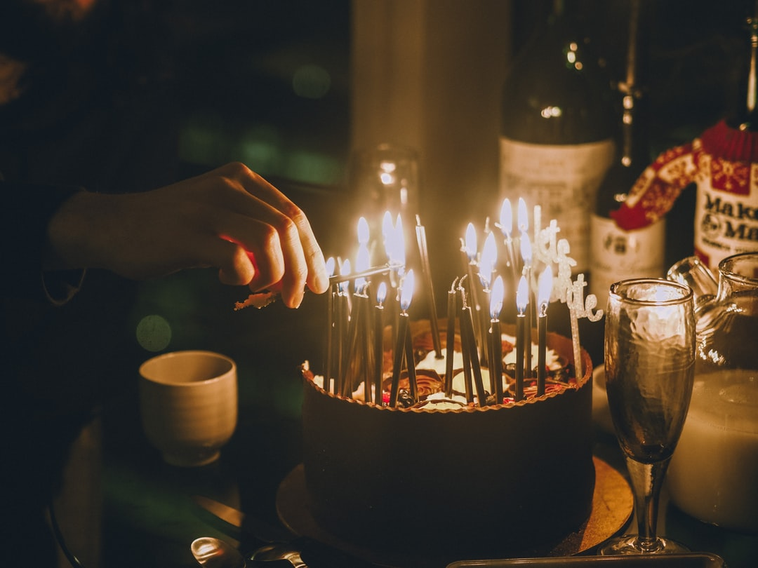 Lighted Candles On Black Table - unsplash