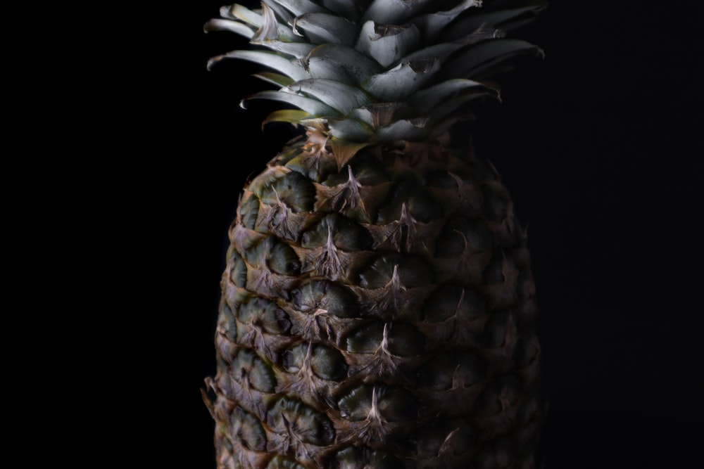 green and yellow pineapple fruit
