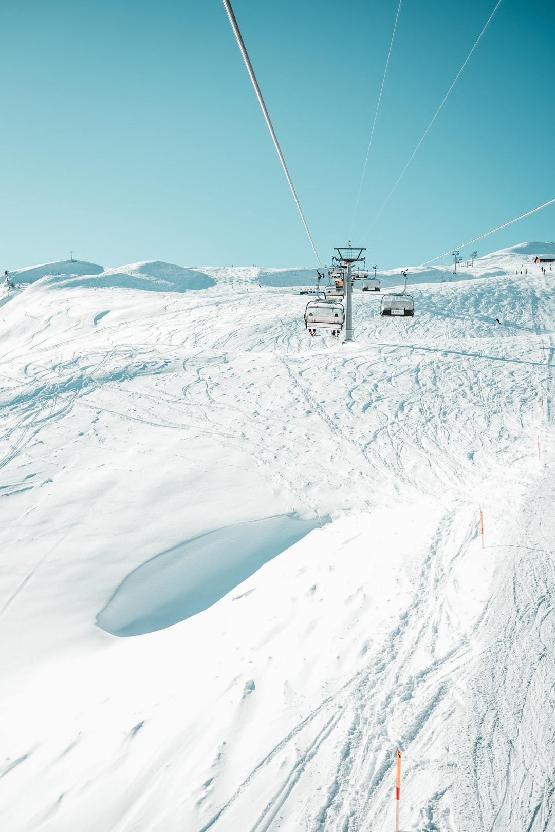 cable car over snow covered mountain during daytime