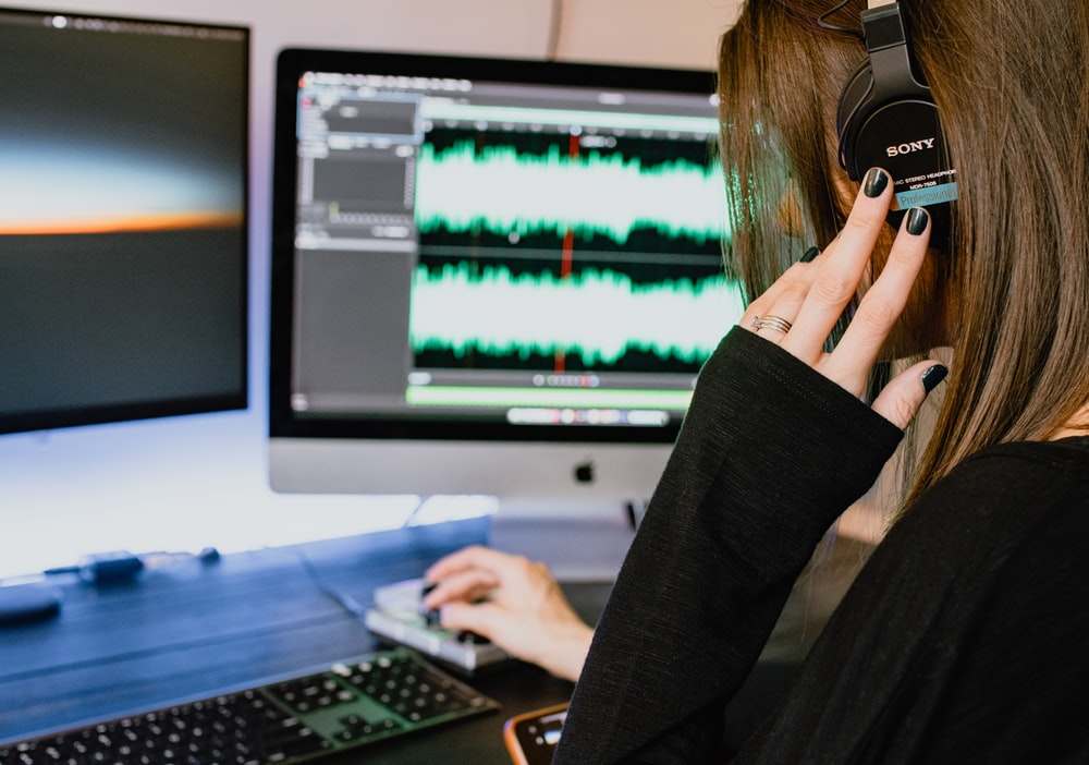 woman in black long sleeve shirt using black laptop computer