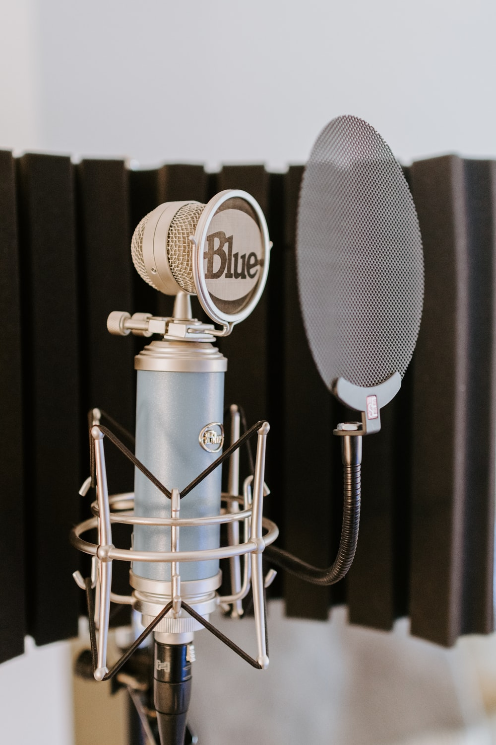 silver and black microphone on black and silver microphone stand