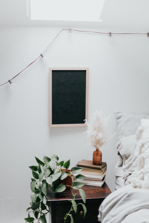 brown wooden rectangular frame on white wall