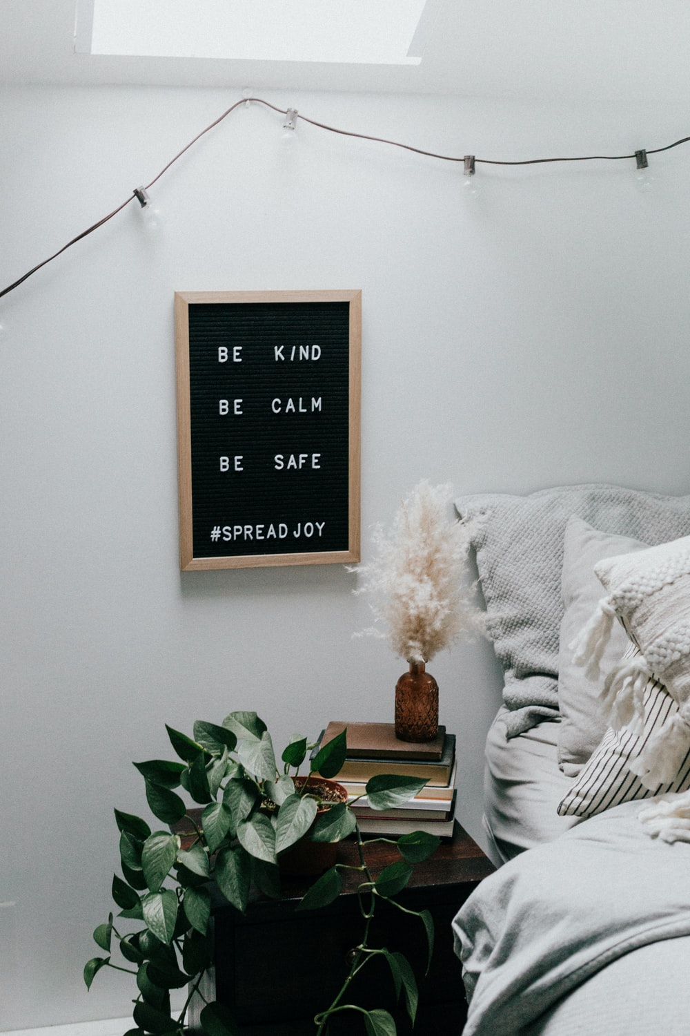 black and white quote board mounted on white wall