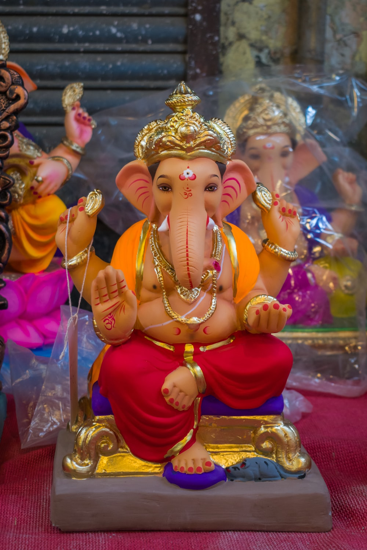 gold hindu deity figurine on table