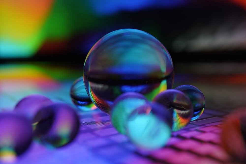 clear glass ball on purple textile