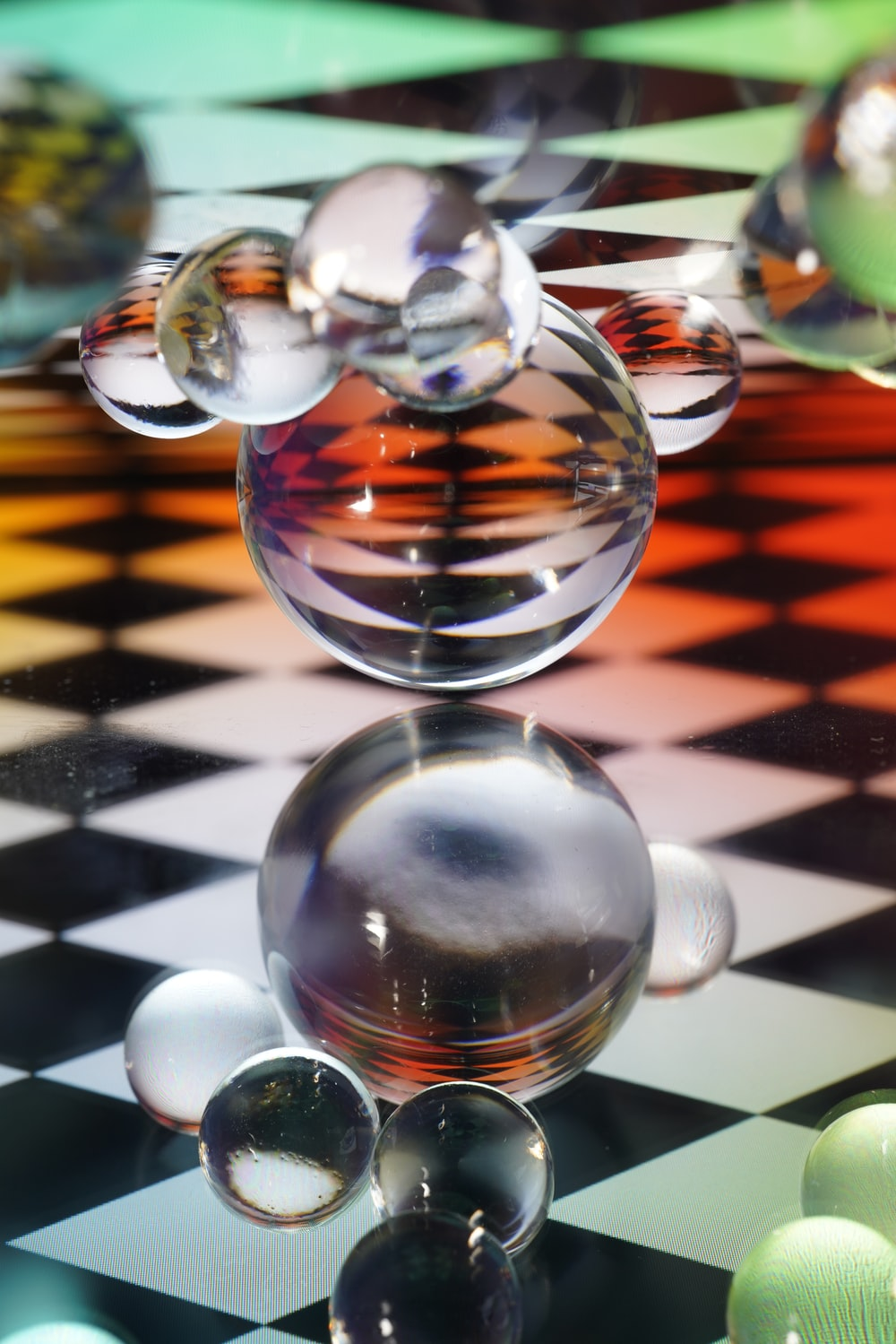 clear glass ball on white and black stripe table