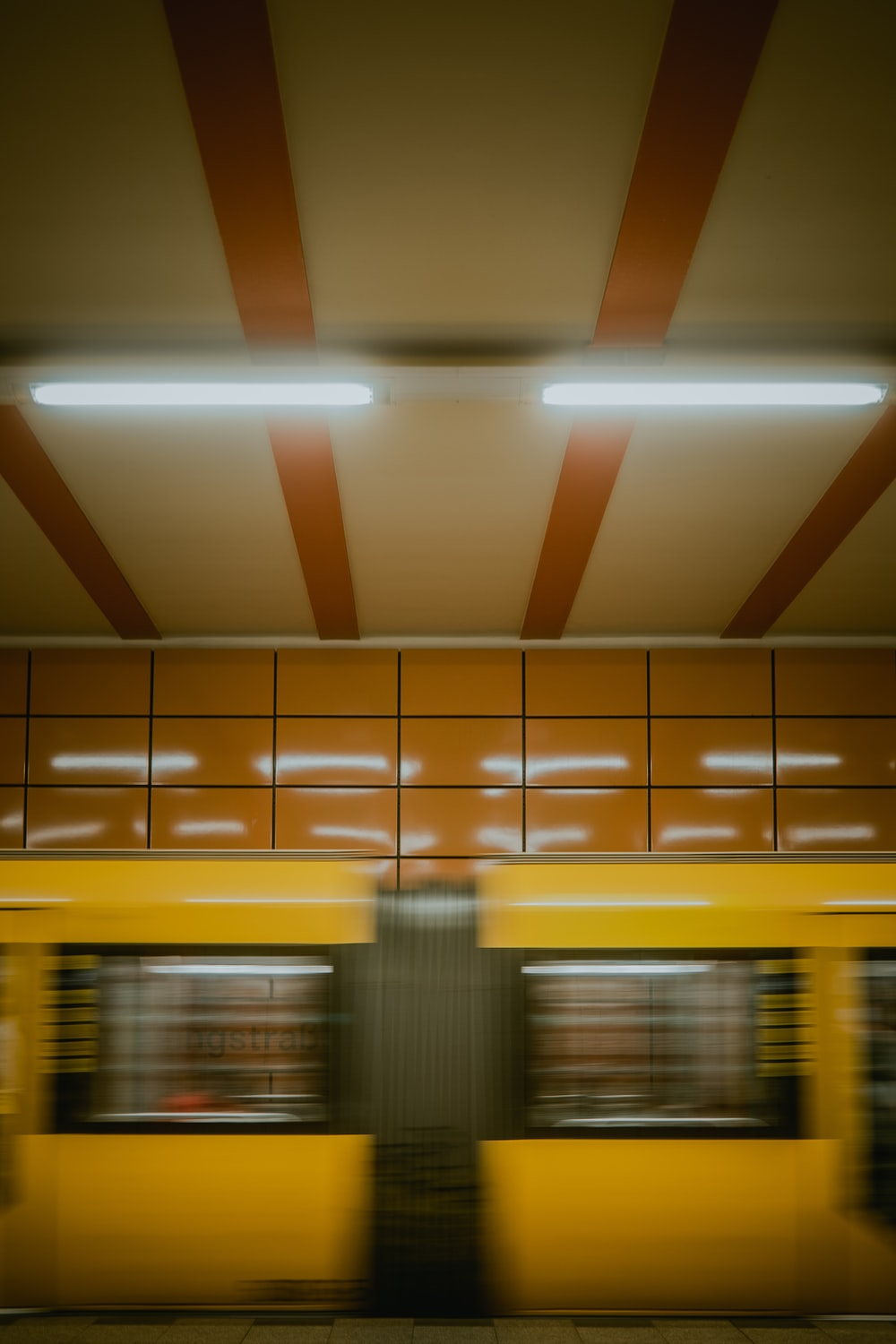 yellow and white train station